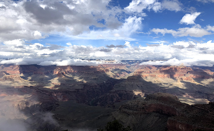 south rim of Grand Canyon with white clouds
