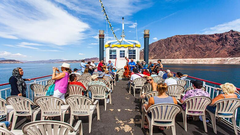 The Lake Mead Lunch Cruise boat with many people on a sunny day at Lake Mead and Hoover Dam