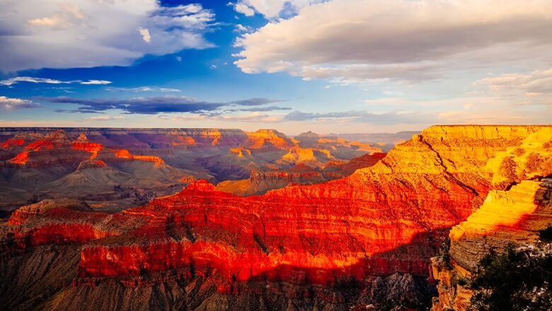 Grand Canyon South Rim view at sunrise with white clouds in the sky