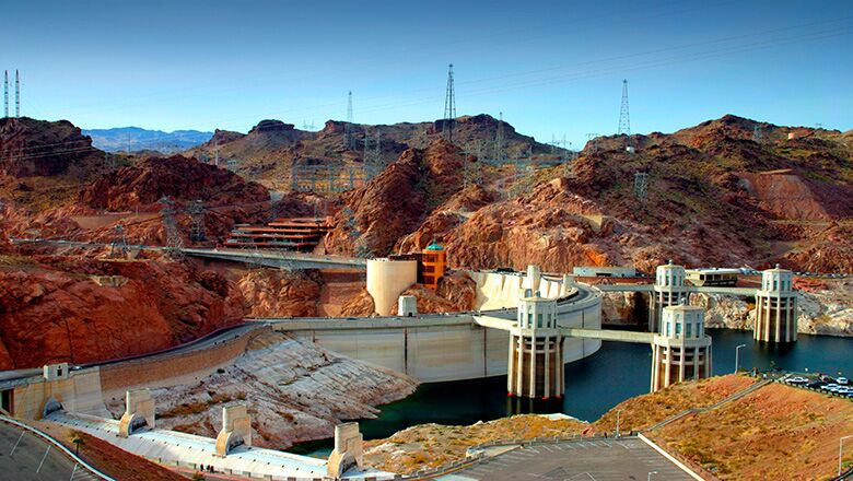 View of the Hoover Dam on a sunny day from the side of Lake Mead