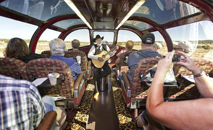 Man singing on the Grand Canyon Railway Train in the glass domed train car.