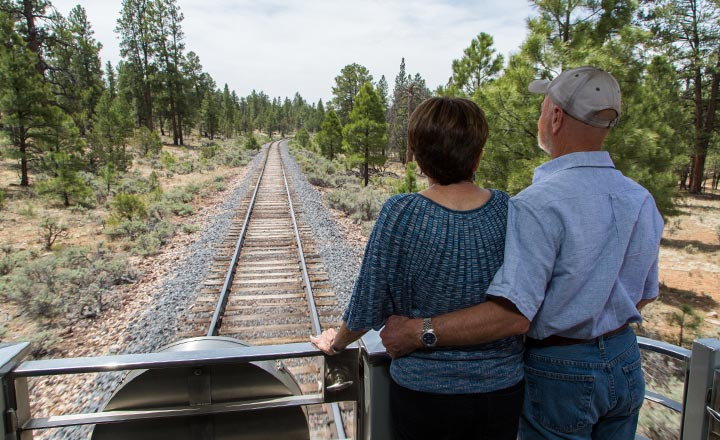 Couple on the back of the Grand Canyon Train.