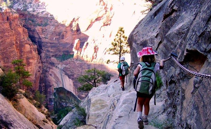 Two children walking down Hidden Canyon Trail in Zion National Park.