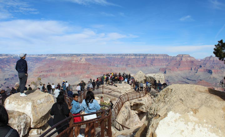 Grand Canyon South Rim visitors enjoying the canyon view from Mather Point in Grand Canyon National Park.