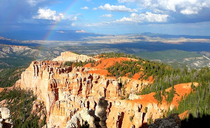 Rainbow showing in the blue sky at Rainbow Point in Bryce Canyon National Park.