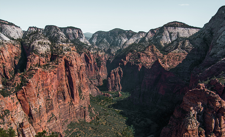 Wide view of Zion canyon from the top of a peak