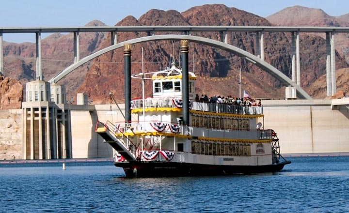 Lake Mead cruise boat in front of the Hoover Dam and Mike O'Callaghan–Pat Tillman Memorial Bridge