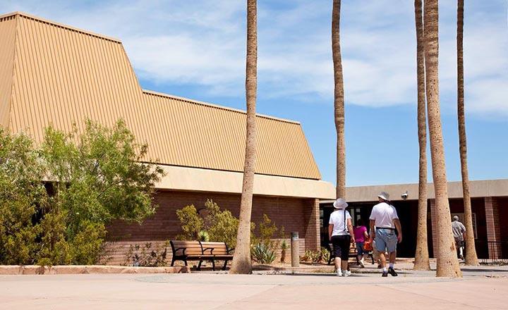 Visitors walk into the Hoover Dam visitors center