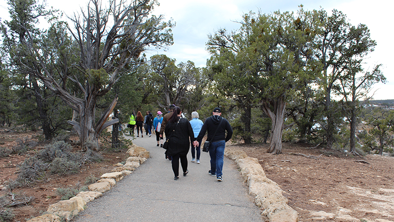 Couple walking along the Trail of Time at the South Rim of the Grand Canyon.